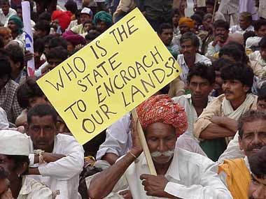 Farmers protest changes to land laws. Credit: PTI