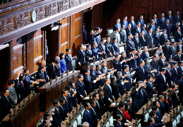 "Lawmakers raise their hands and shouts ""banzai"" (cheers) after the dissolution of lower house was announced at the Parliament in Tokyo, Japan September 28, 2017. Credit: Reuters"
