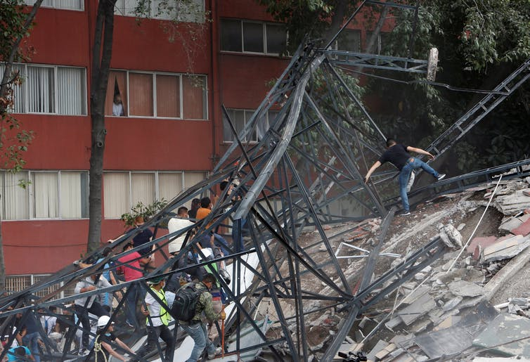 Mexico City residents are forming spontaneous work brigades to save neighbors' lives. Credit: Reuters