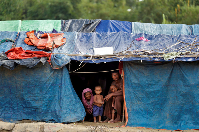 Rohingya refugees wait in a refugee camp in no mans land in Cox's Bazar, Bangladesh, September 24, 2017. Credit: Reuters