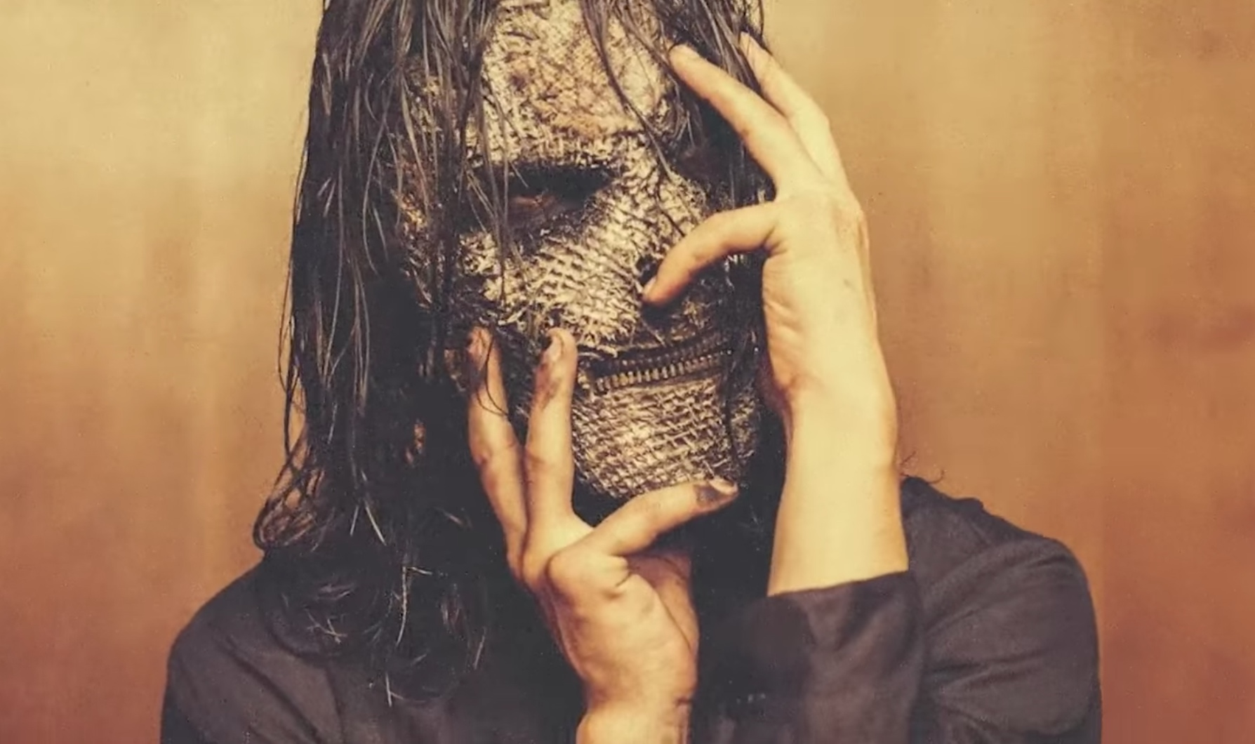 During stage performances, the members of the band Slipknot wear custom-designed facemasks like the one shown above. Source: YouTube/Slipknot