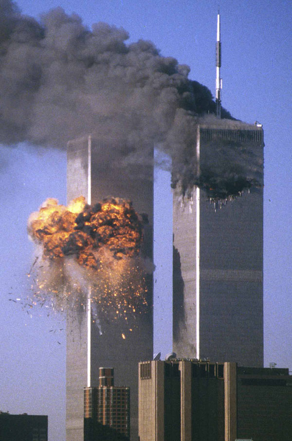 United Flight 175 crashes into the south tower (L) of the World Trade Center in New York as the north tower burns after being hit by American Flight 11 a short time earlier, in this file photo from September 11, 2001. Credit: Reuters