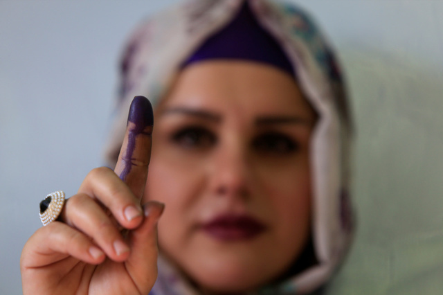 A woman shows her ink-stained finger during Kurds independence referendum in Halabja, Iraq. Credit: Reuters