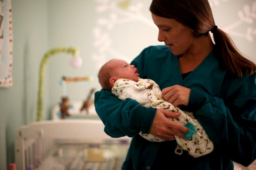 Lisa Collinsworth holds her infant son Luke during a visit with him at Lily's Place, a treatment center for opioid-dependent newborns in Huntington, West Virginia, October 19, 2015.