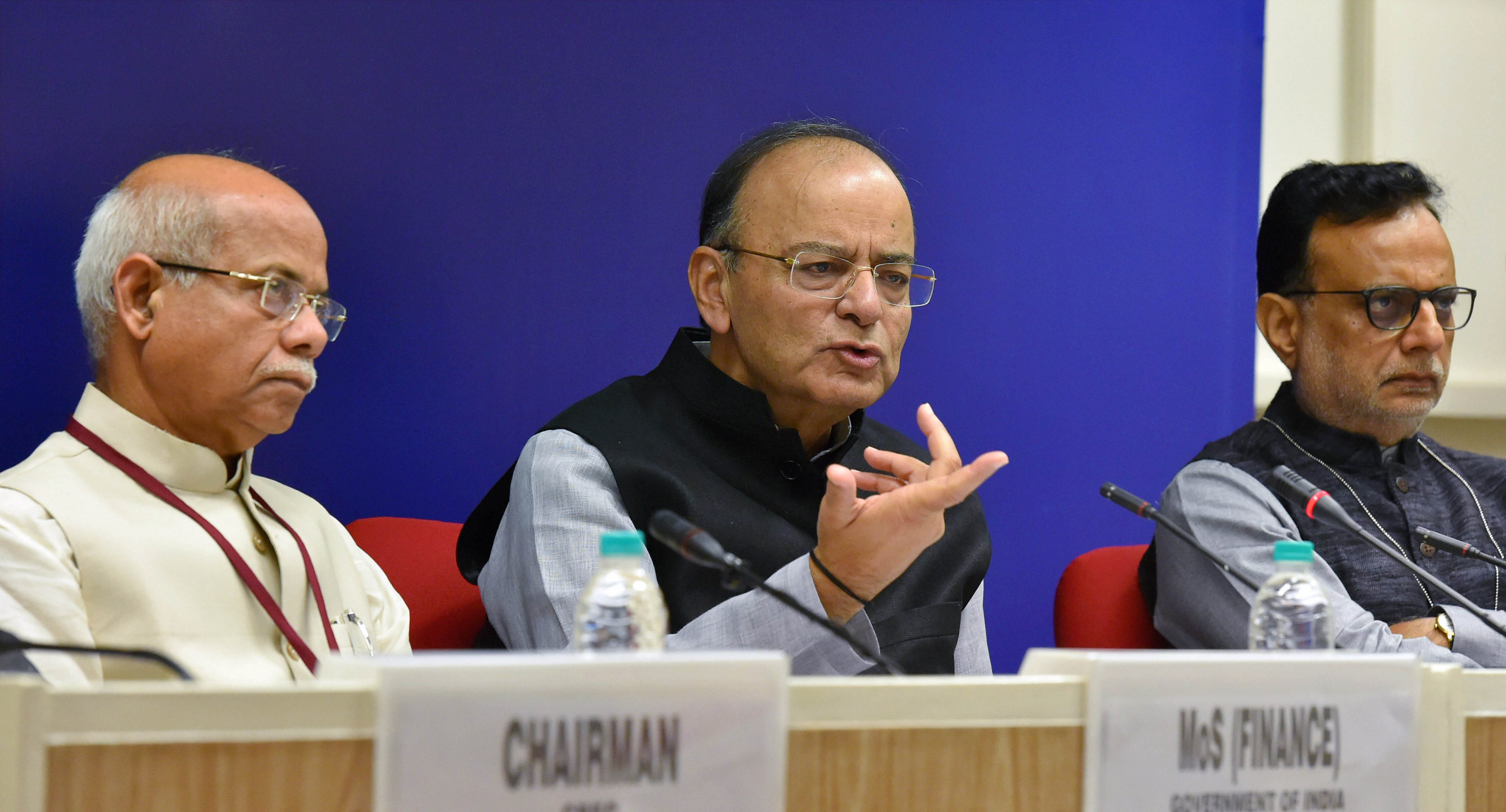 Union finance minister Arun Jaitley with MoS for finance Shiv Pratap Shukla and revenue secretary Hasmukh Adhia addressing media after the 22nd meeting of the Goods and Services Tax (GST) Council, in New Delhi on Friday. Credit: PTI/Atul Yadav