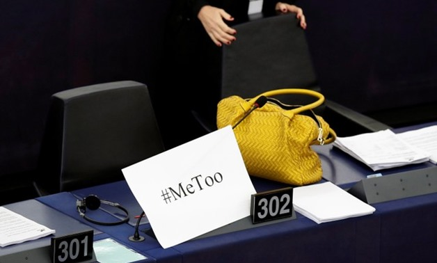 "A placard with the hashtag ""MeToo"" is seen on a European Parliament member's desk in Strasbourg. Credit: Reuters"