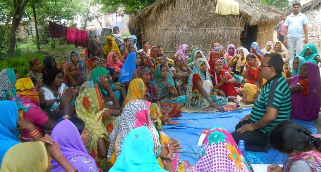 Women of Nari Sangh, the collective, hold discussions with representatives of a community-based organization about the village clinic. Credit: Lokpriya Janhit Sewa Sansthan
