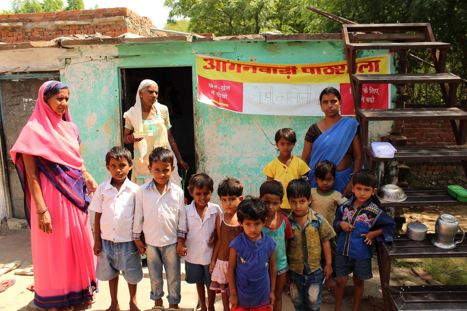 Kids standing outside their anganwadi centre that runs from a small rented room in the basti