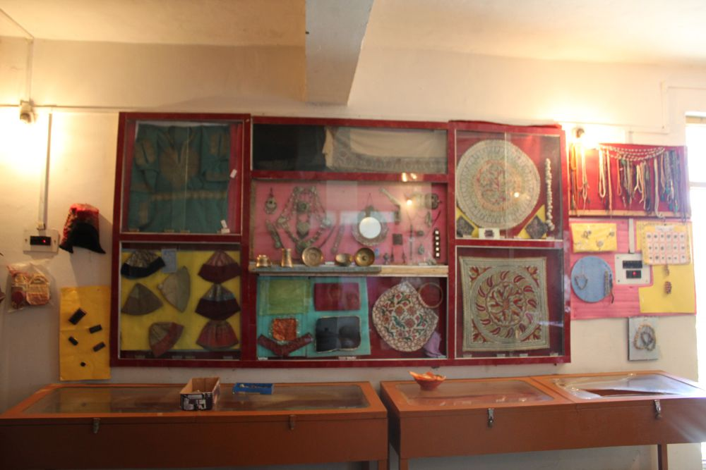 Jewelry, traditional Kashmiri caps and other items from the past stored in one of the rooms of the museum. Credit: Bhavneet Kaur