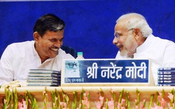 File photo of Prime Minister Narendra Modi and RSS leader Dattatreya Hosabale. Credit: PTI