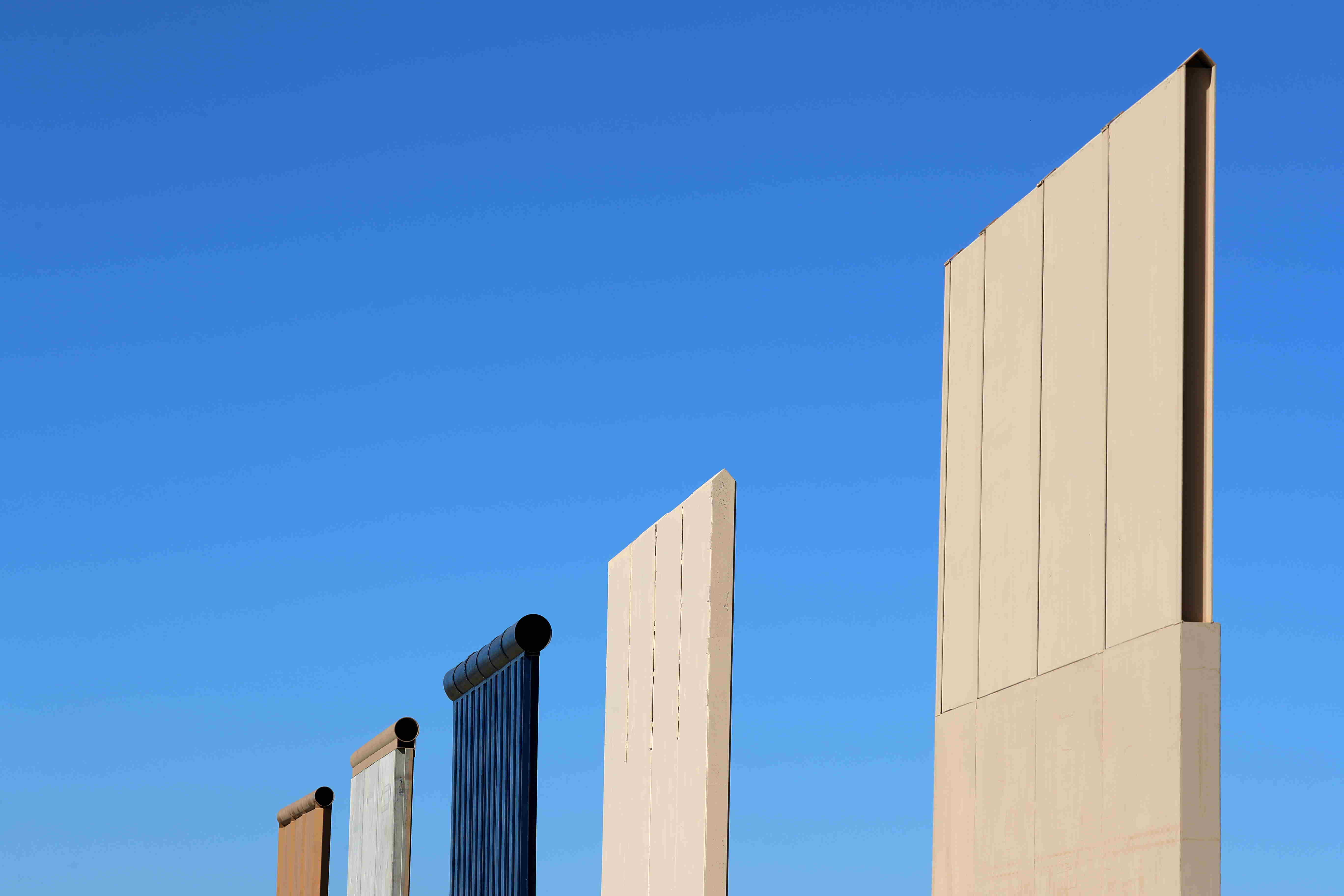 The top of five of U.S. President Donald Trump's eight border wall prototypes are shown near completion along U.S.- Mexico border near San Diego, California. Credit: Reuters/Mike Blake