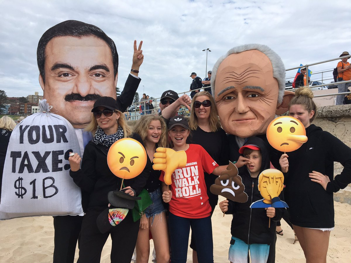 Protestors wear masks of Gautam Adani and Malcolm Turnbull, depicting the unpopular billion dollar government subsidy. Credit: Stop Adani Alliance