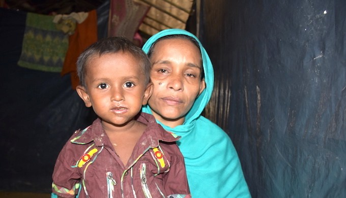 Rokeya Begum has fled to Bangladesh with her children from Bolirbazar in Maungdaw district of Rakhine state in Myanmar. She doesn't know whether her husband is still alive (Photo by Zobaidur Rahman)