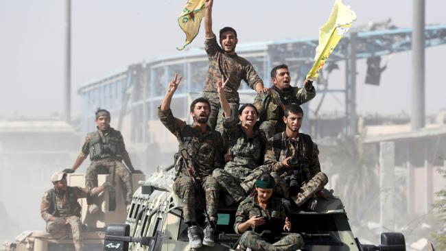 SDF fighters celebrate in Raqqa. Credit: Reuters