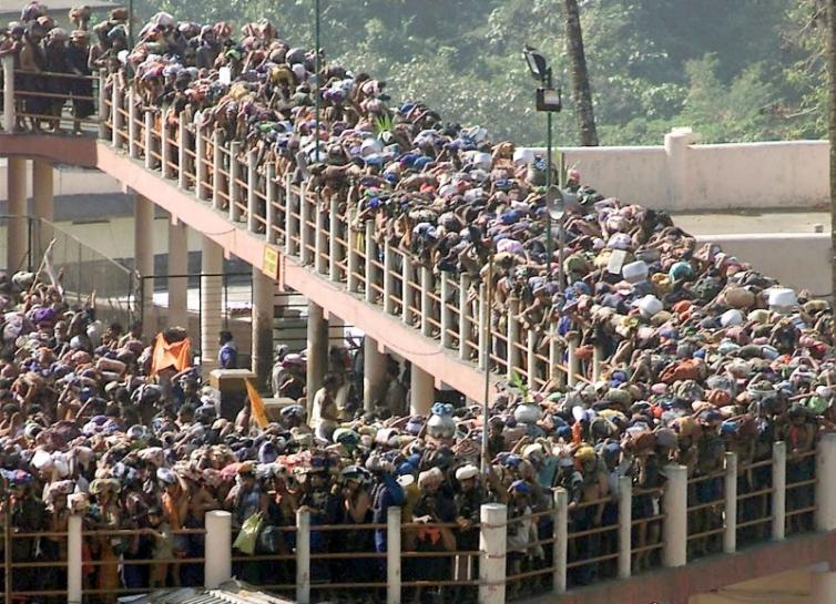 "Hindu pilgrims queue outside the Sabarimala Temple to offer prayers to the Hindu deity ""Ayappa"", about 70 kms west of the town Pathanamthtta in Kerala, on January 15, 2003. Credit: Reuters/Dipak Kumar/Files"