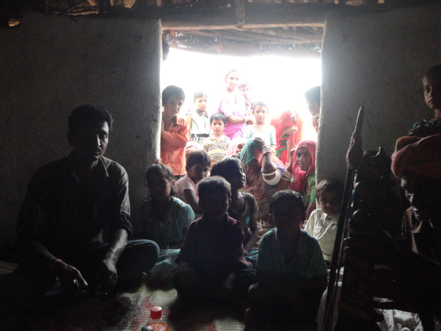 Villagers crowd his hut to hear him sing