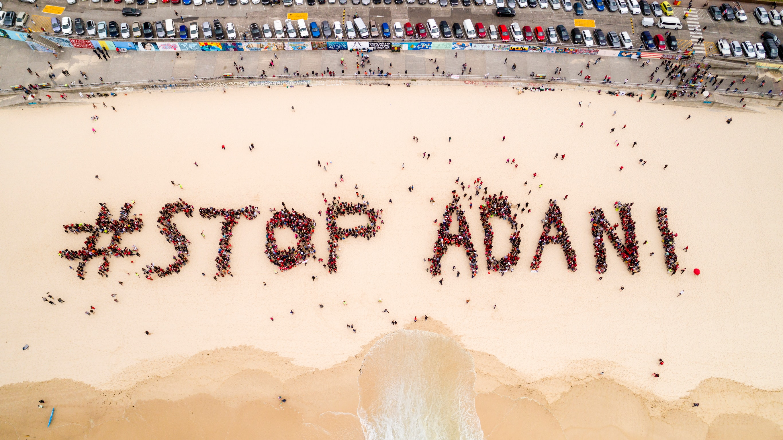 The human formation in Bondi beach in Sydney on October 7. Credit: StopAdaniAlliance.