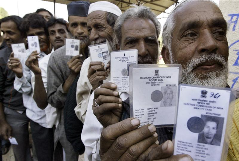 Voters show their voter identity cards as they wait for their turn to cast their ballot during the Madhya Pradesh state assembly election, at a polling booth in Bhopal November 27, 2008. Credit: Reuters/Raj Patidar