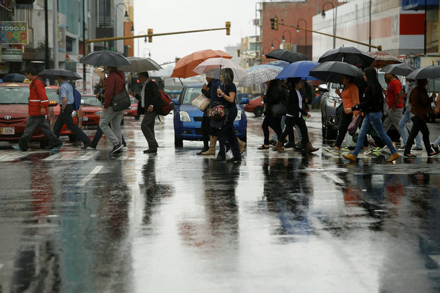 People walk on the main street of the city of San Jose, during heavy rains by Tropical Storm Nate, Costa Rica October 5, 2017. Credit: Reuters