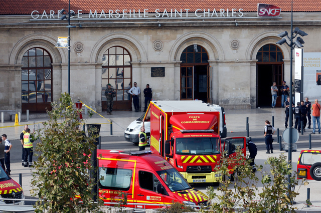 Emergency services vehicles are seen outside the Saint-Charles train station after French soldiers shot and killed a man who stabbed two women to death at the main train station in Marseille, France, October 1, 2017. Credit: Reuters