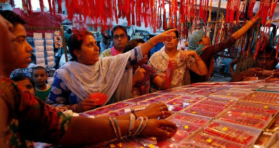 Women shop at a stall selling rakhis at a market in Ahmedabad