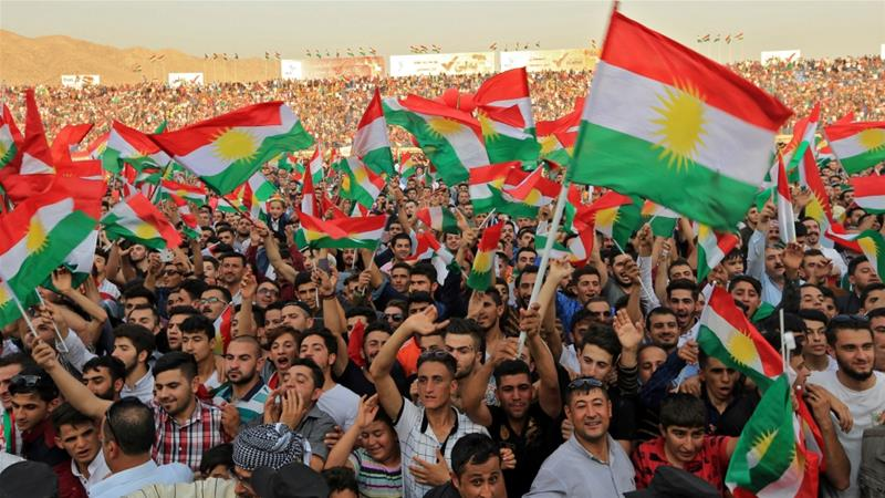 Kurdish people attend a rally to show their support for the independence referendum. Credit: Ari Jalal/Reuters