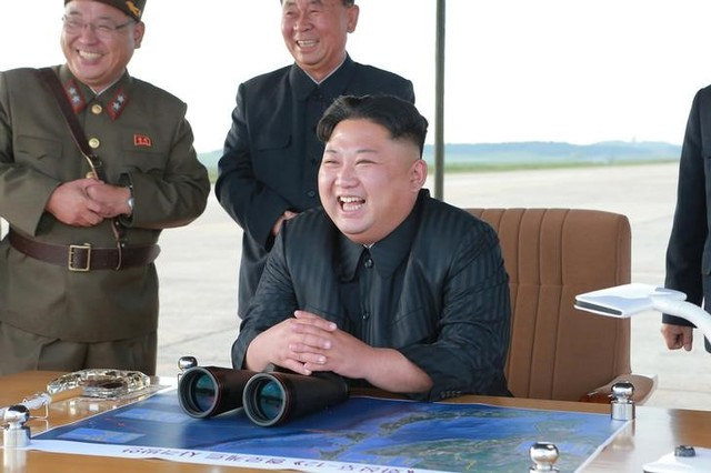 North Korean leader Kim Jong Un guides the launch of a Hwasong-12 missile in this undated photo released by North Korea's Korean Central News Agency (KCNA) on September 16, 2017. Credit: Reuters