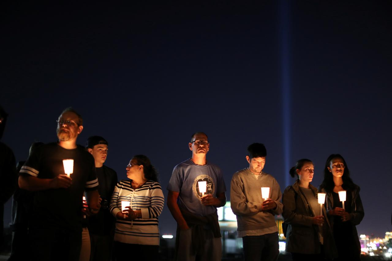 People pray during a candlelight vigil for victims of the Route 91 music festival mass shooting next to the Mandalay Bay Resort and Casino in Las Vegas, Nevada, U.S. October 3, 2017. Credit: Reuters