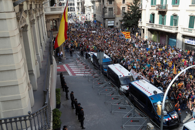People walk past National Police main police station during a demonstration two days after the banned independence referendum in Barcelona, Spain, October 3, 2017. Credit: Reuters