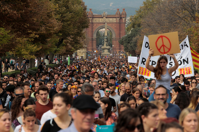 People walk during a demonstration two days after the banned independence referendum in Barcelona, Spain, Credit: Reuters