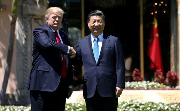 US President Donald Trump (L) and China's President Xi Jinping shake hands while walking at Mar-a-Lago estate after a bilateral meeting in Palm Beach, Florida, US., April 7, 2017. Credit: Reuters