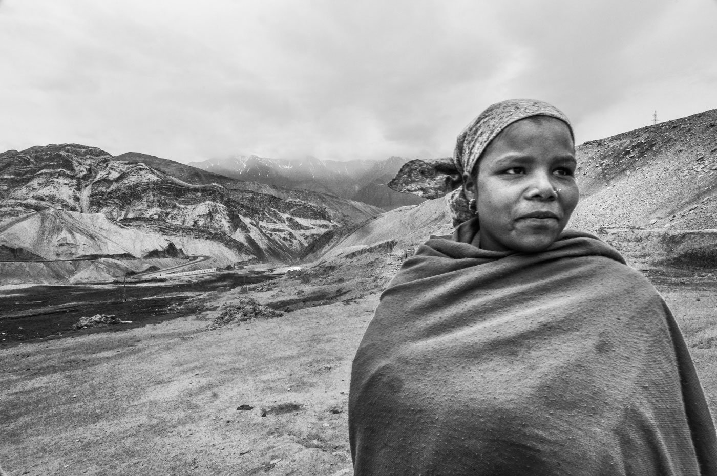 Sandhya Rani Murmu is from Jharkhand, among the few women at the work sites; she has come to visit her brother, she says, and is pitching in with the road building near Durbok village, between the Chang La pass and Tagste. Mud slides are common at Chang La, so there's a constant need for labourers.