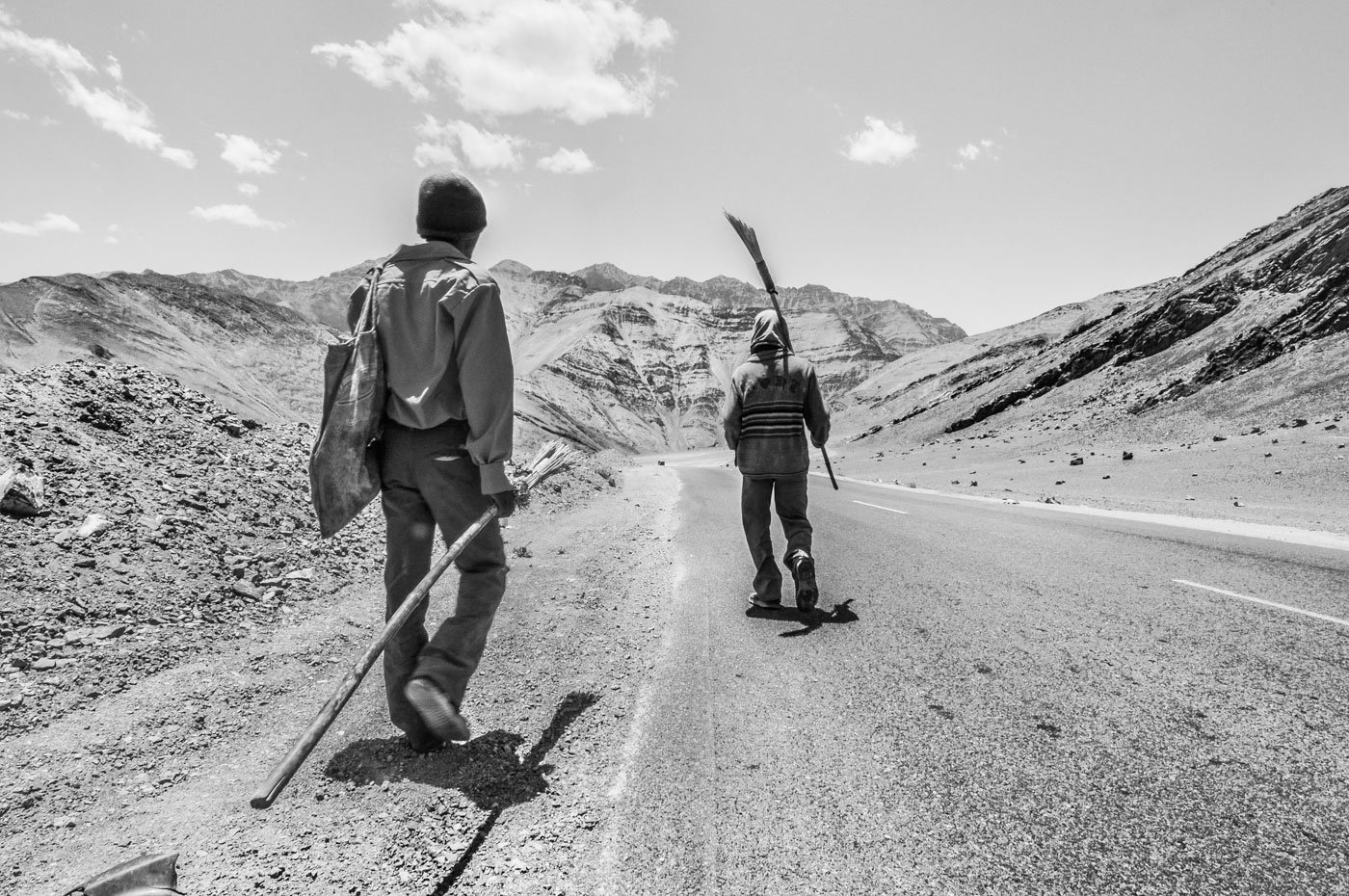 Two workers from Jharkhand walk towards their tent close to the Magnetic Hill as the day ends