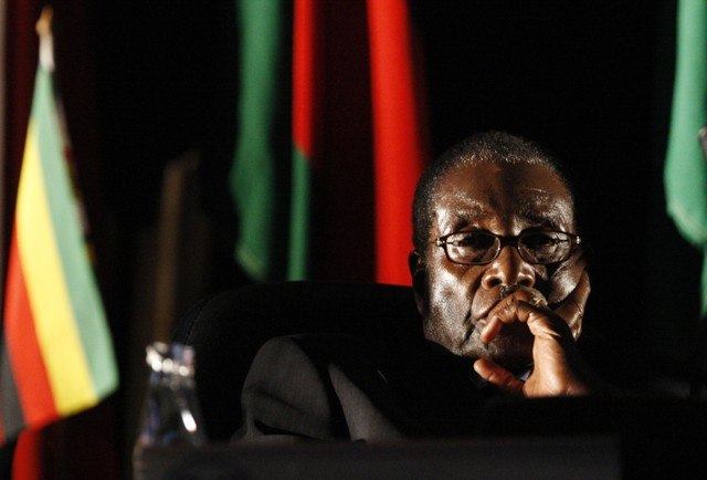 FILE PHOTO - Zimbabwean President Robert Mugabe watches a video presentation during the summit of the Southern African Development Community in Johannesburg, August 2008. Credit: Reuters/Mike Hutchings