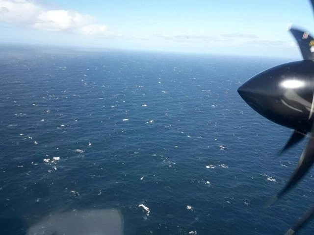 An Argentine Navy airplane is seen as it flies over the Atlantic Ocean during the search for the ARA San Juan submarine missing at sea, Argentina November 22, 2017. Argentine Navy/Handout via Credit: Reuters