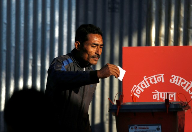 A man cast his vote on a ballot box during the parliamentary and provincial elections at Chautara in Sindhupalchok District November 26, 2017. Credit: Reuters/Navesh Chitrakar