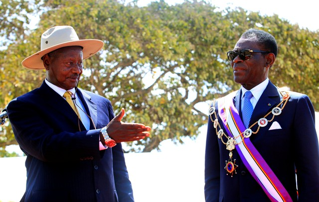 FILE PHOTO: Uganda President Yoweri Museveni (L) decorates his Equatorial Guinea counterpart Teodoro Obiang Nguema Mbasogo during the Pearl of Africa medal awards ceremony during Uganda's ruling party 26th anniversary January 27, 2012 in Kapchorwa district, 287km (172 miles) east of capital Kampala. The Pearl of Africa and Kagera awards are the highest honour reserved for the heads of state, in recognition of contribution to the 1981-1986 National Resistance Movement and army (NRM/NRA) liberation struggle of Uganda. Reuters/James Akena/File Photo