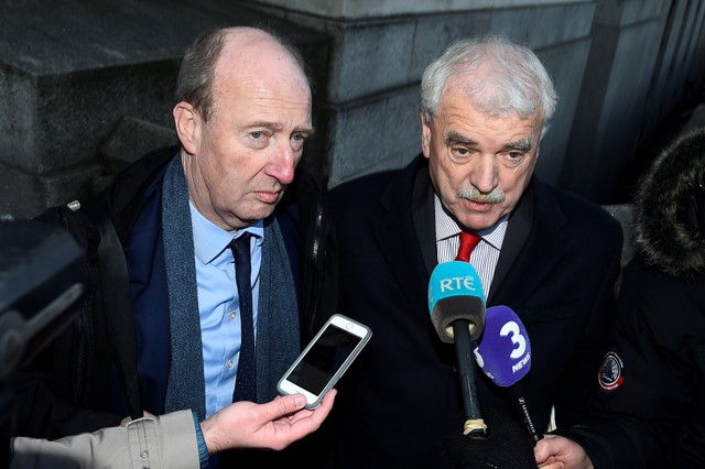 Transport Minister Shane Ross (L) and Finian McGrath, both of the Independent Alliance Party speak to media as they arrive at Government buildings in Dublin, Ireland, November 28, 2017. Credit: Reuters/Clodagh Kilcoyne