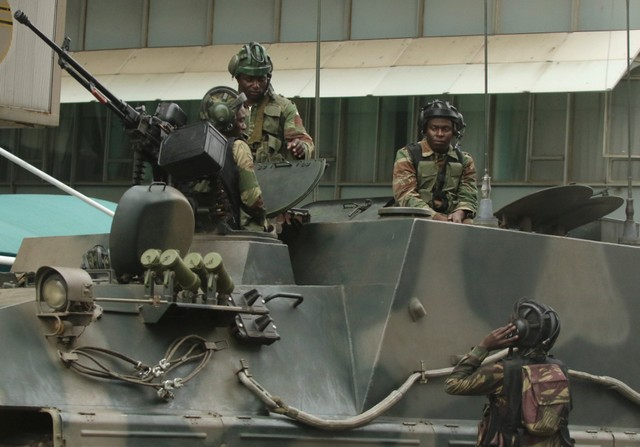 Soldiers are seen on the armoured vehicle outside the parliament in Harare, Zimbabwe, November 16, 2017. Credit: Reuters/Philimon Bulawayo