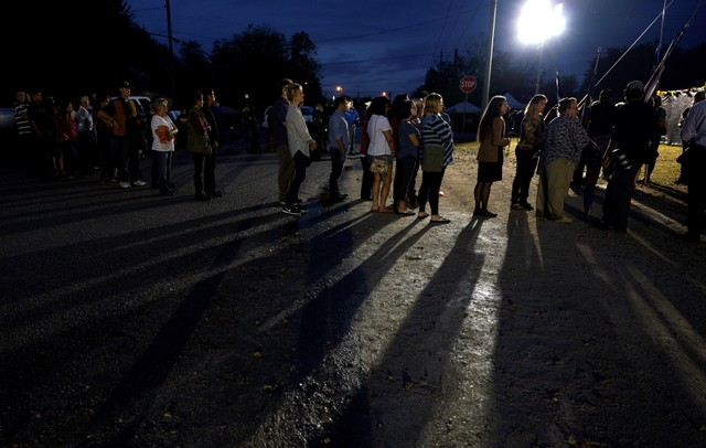 People wait to tour the First Baptist Church of Sutherland Springs where 26 people were killed last week in a shooting attack, as the church was opened to the public as a memorial to those killed, in Sutherland Springs, Texas, US November 12, 2017. Credit: Reuters/Rick Wilking