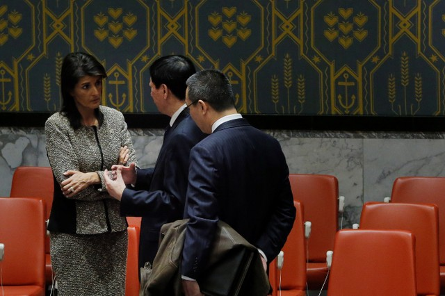 United States ambassador to the United Nations (UN) Nikki Haley speaks with Chinese Deputy UN Ambassador Wu Haitao after a meeting of the UN Security Council to discuss a North Korean missile launch at UN headquarters in New York, US, November 29, 2017. Credit: Reuters/Lucas Jackson