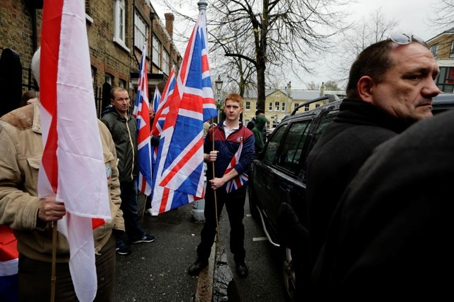 A man holds the Union Flag whilst attending a Britain First rally in Rochester, Britain November 15, 2014. Picture taken November 15, 2014. Credit: Reuters/Kevin Coombs