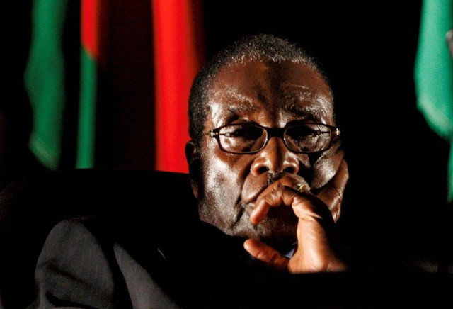 Zimbabwean President Robert Mugabe watches a video presentation during the summit of the Southern African Development Community (SADC) in Johannesburg, South Africa August 17, 2008. Credit: Reuters/Mike Hutchings/Files