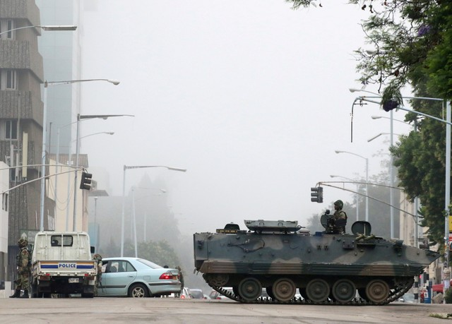 Military vehicles and soldiers patrol the streets in Harare, Zimbabwe, November 15, 2017. REUTERS/Philimon Bulawayo/Files