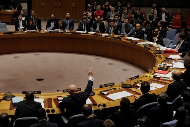 Representatives of Russia and Bolivia vote in the United Nations (UN) Security Council on a bid to renew an international inquiry into chemical weapons attacks in Syria during a meeting at the UN headquarters in New York, US, November 16, 2017. Credit: Reuters/Lucas Jackson