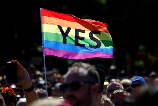 Supporters of the 'Yes' vote for marriage equality celebrate after it was announced the majority of Australians support same-sex marriage in a national survey, paving the way for legislation to make the country the 26th nation to formalise the unions by the end of the year, at a rally in central Sydney, Australia, November 15, 2017. Credit: Reuters/David Gray