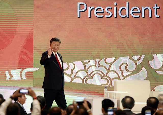 At APEC Meeting, China's Xi Vows to 'Open Wider' While Defending Jobs