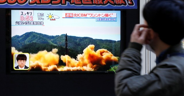 A man looks at a street monitor showing a news report about North Korea's missile launch, in Tokyo, Japan, November 29, 2017. Credit: Reuters/Toru Hanai
