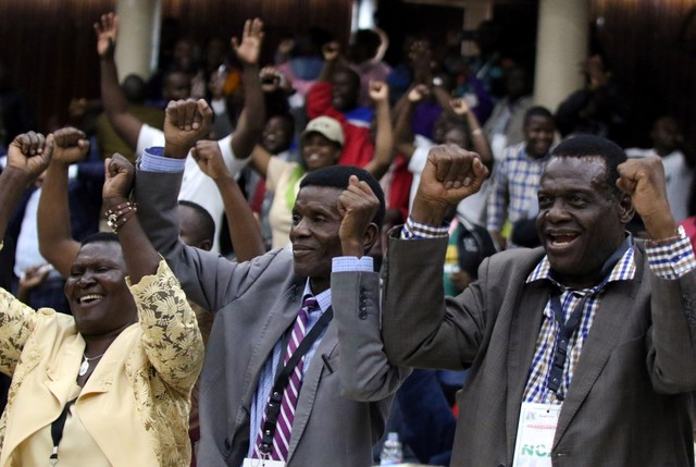 Delegates celebrate after Zimbabwean President Robert Mugabe was dismissed as party leader at an extraordinary meeting of the ruling ZANU-PF's central committee in Harare, Zimbabwe, November 19, 2017. Credit: Reuters/Philimon Bulawayo