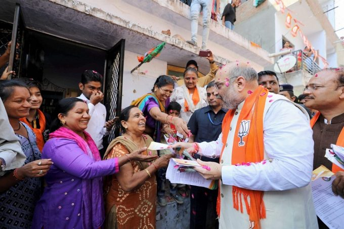 BJP president Amit Shah during his door-to-door campaign for assembly polls, in Naranpura, Gujarat. Credit: PTI